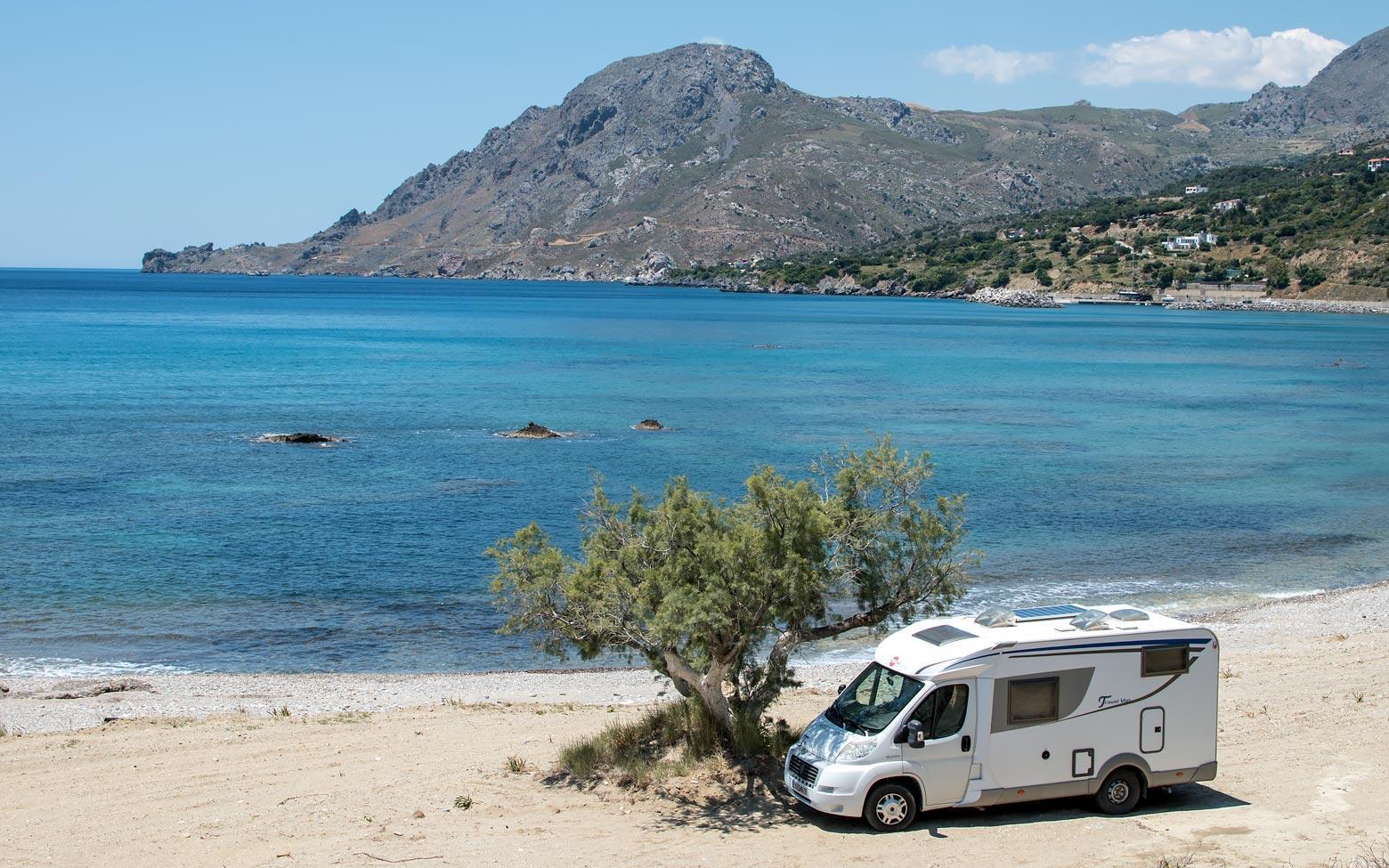 photo of a car on a crete beach