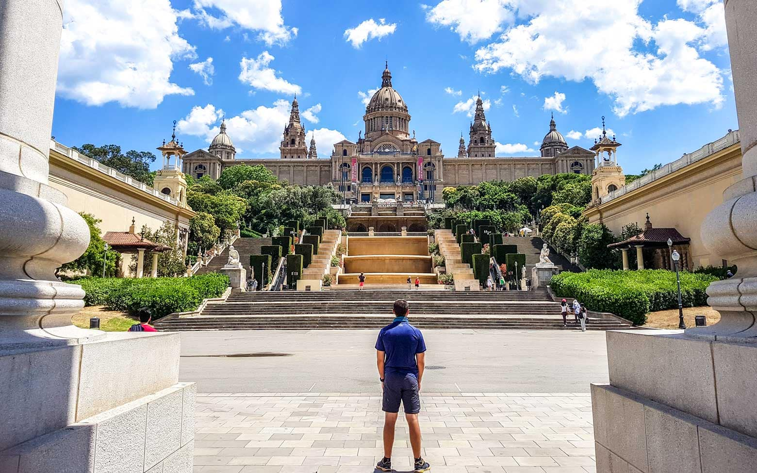 man standing in front of a museum in barcelona