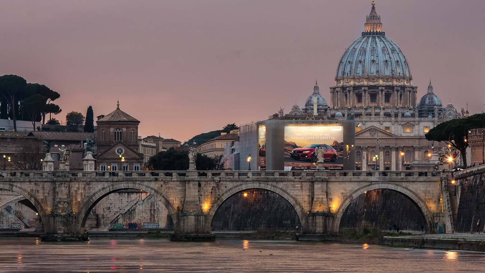 dome of the vatican city and the river Tiber on sunset