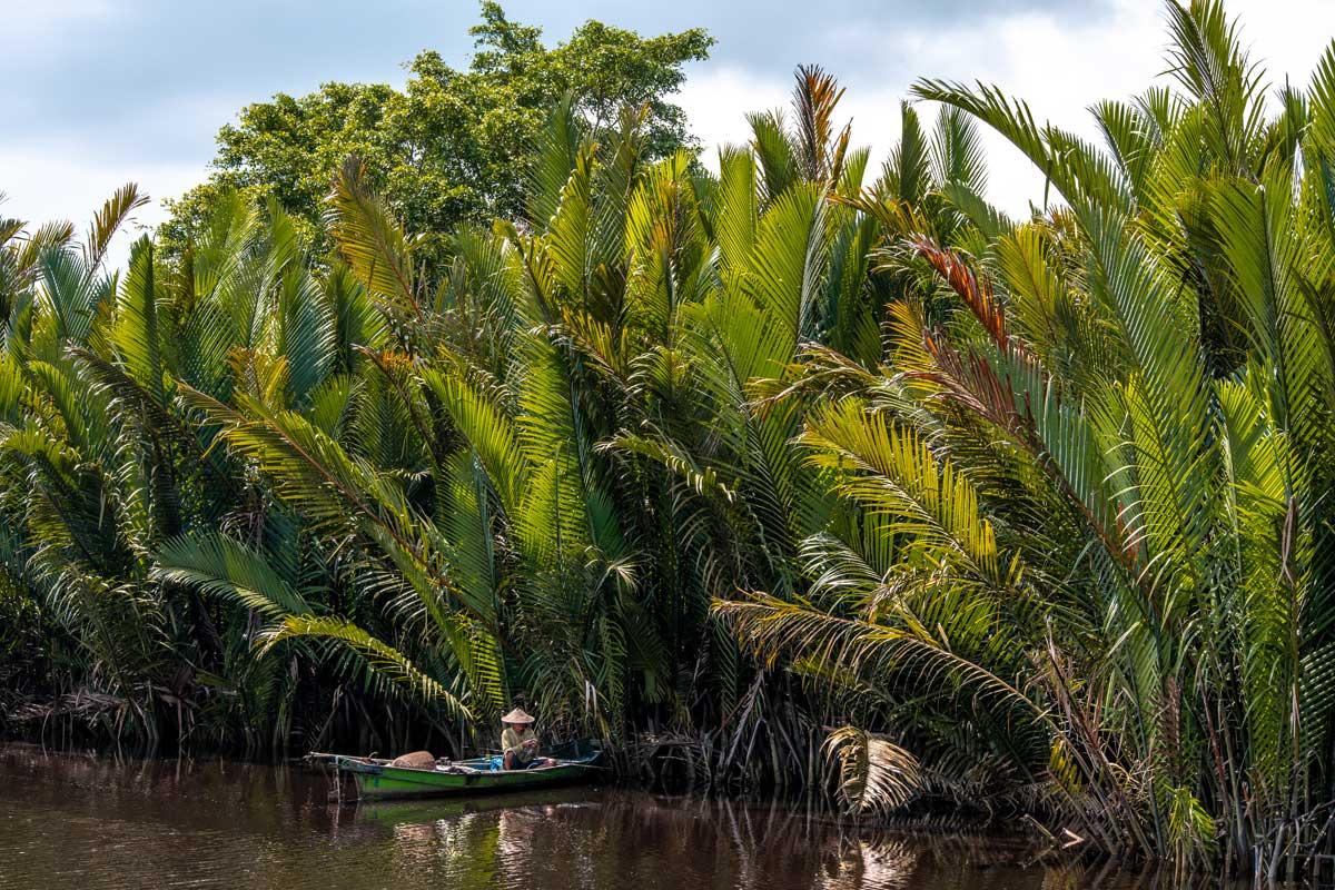 Borneo Orangutan Tour - fisherman in the river