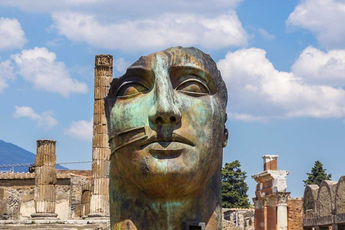 TOP Unesco sites in Italy - Pompeii, picture of ancient head monument