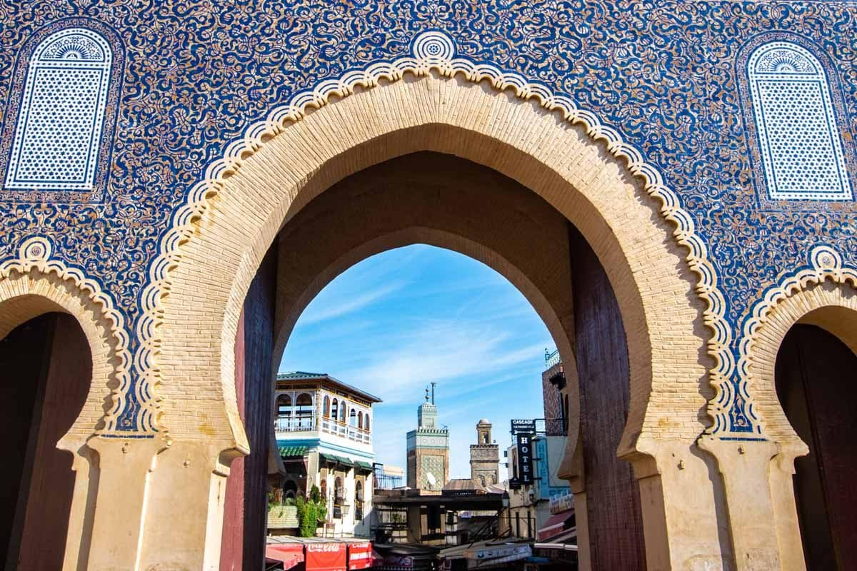 the blue gate in Fes with minaret in the background