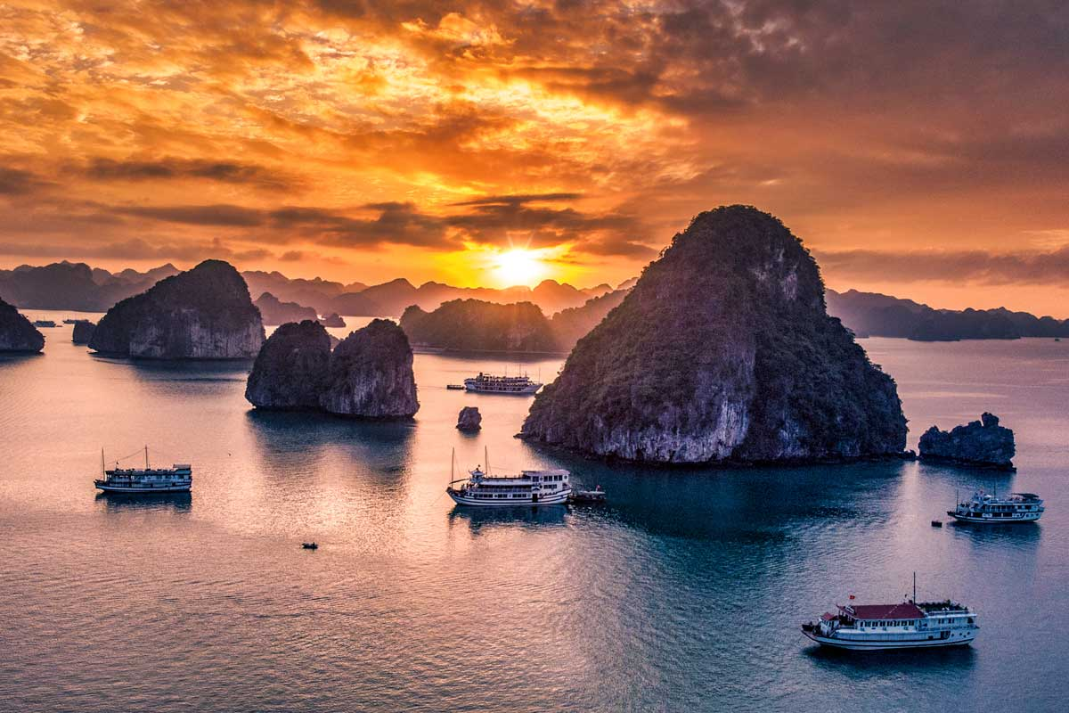 sunset on a Halong Bay cruise-southeast-asia-bucket-list