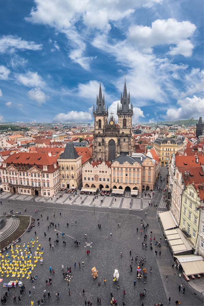 what is prague famous for -old-town-square with picturesque sky
