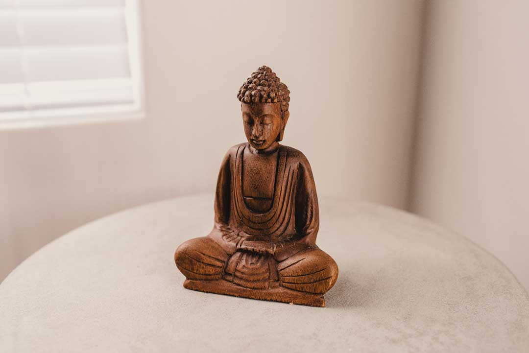 decorative buddha statue in a white room