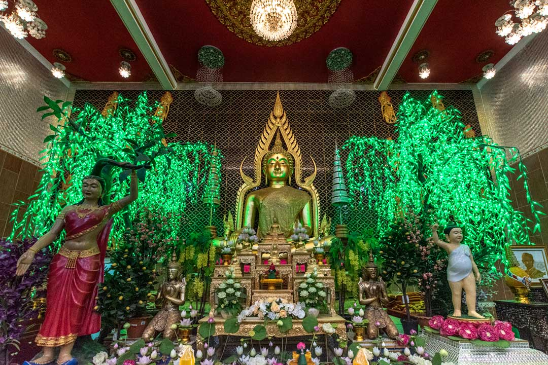 buddha-statue-with-green-lights-on-the-background
