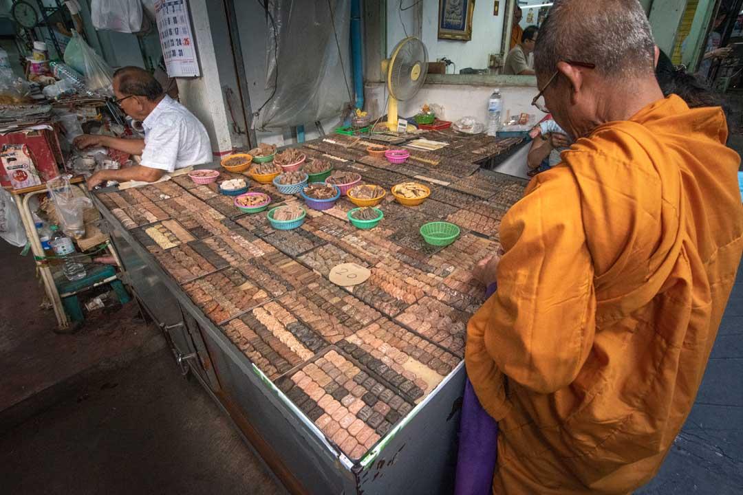 monk-shopping-at-the-amulet-market-in-bangkok