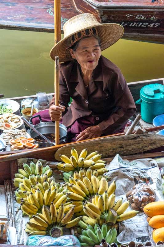 landmarks in thailand - floating market vendor