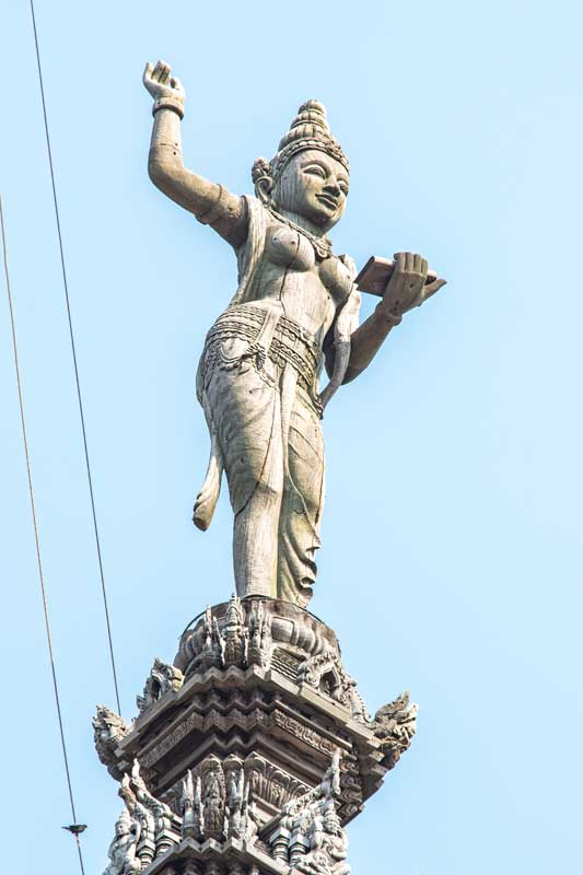 girl-holing-scripture-on-sanctuary-of-truth-pattatya-rooftop