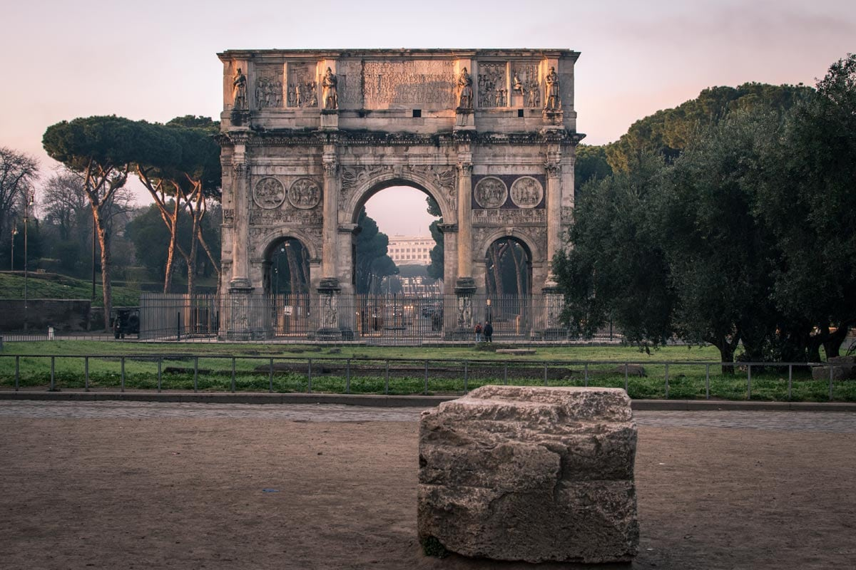 Arc-with-a-stone-in-front-of-it-in-Rome-at-dawn