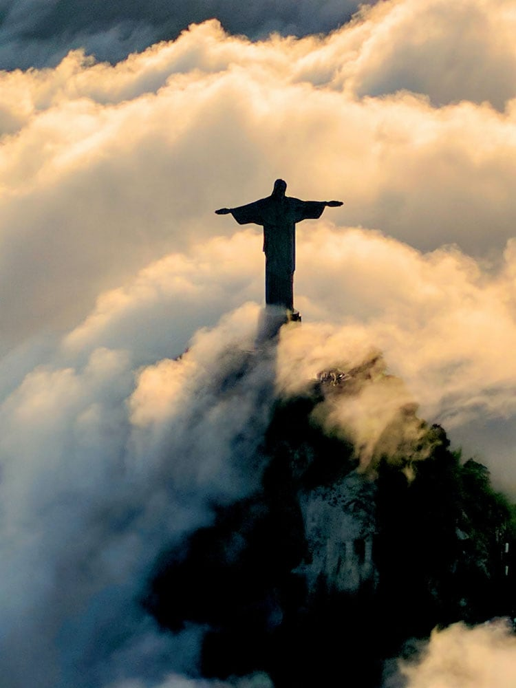 christ-statue-surrounded-by-clouds