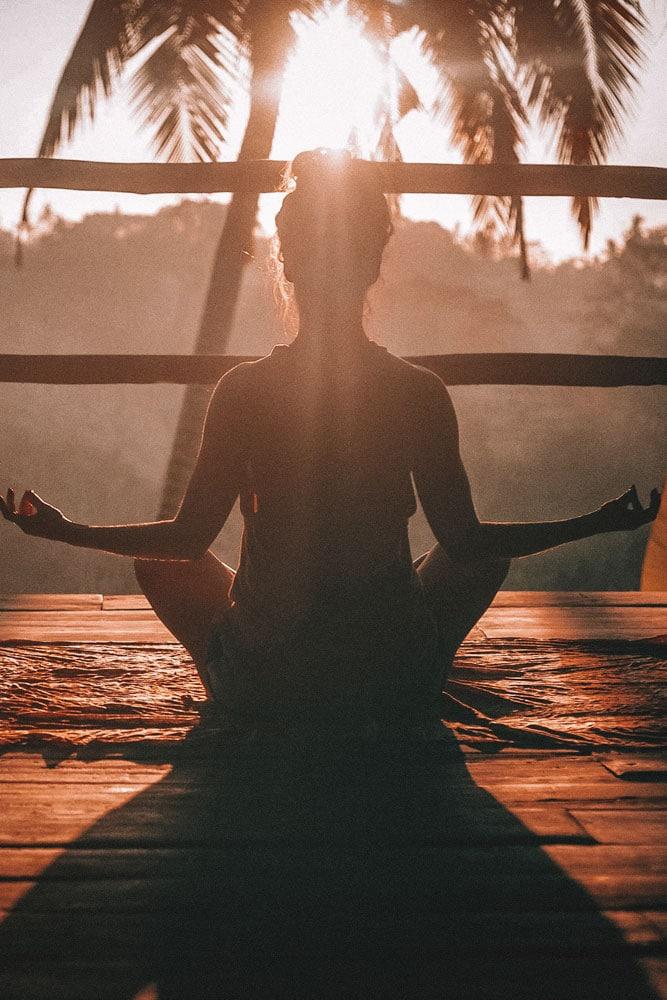 girl-doing-yoga-on-sunrise