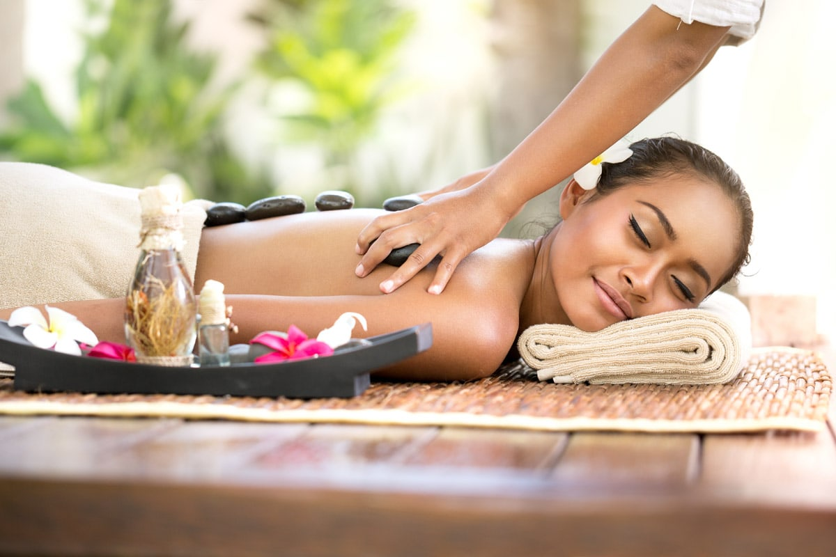 interesting facts about bali - girl-having-a-volcanic-stone-massage