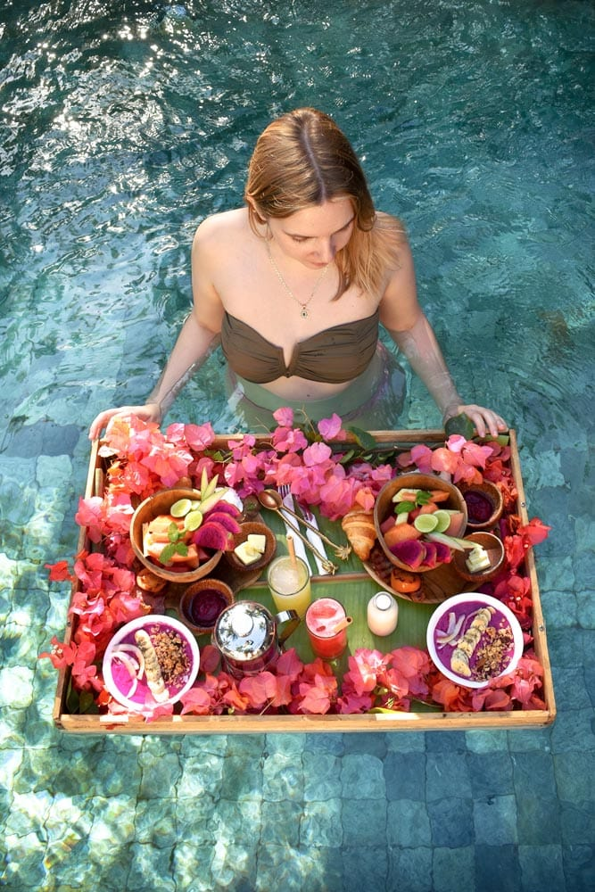 girl-in-a-pool-with-a-floating-breakfast