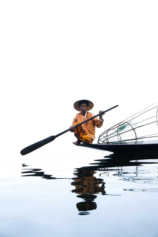 inle-lake-fisherman-sitting-on-its-boat-southeast-asia-bucket-list