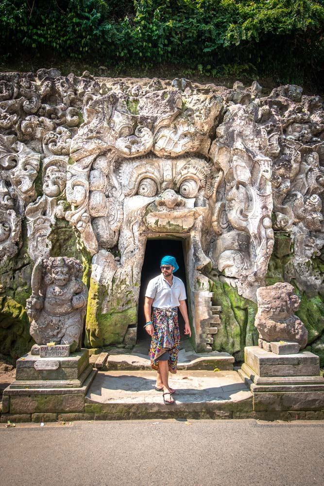 man-in-front-of-a-carved-cave