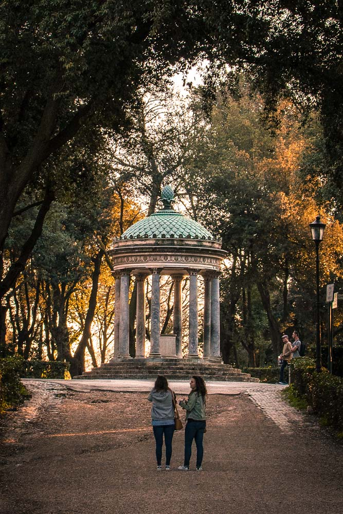 two-girls-walking-in-villa-borghese