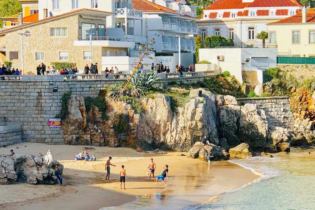 lisbon bucket list people-playing-football-on-a-cascais-beach