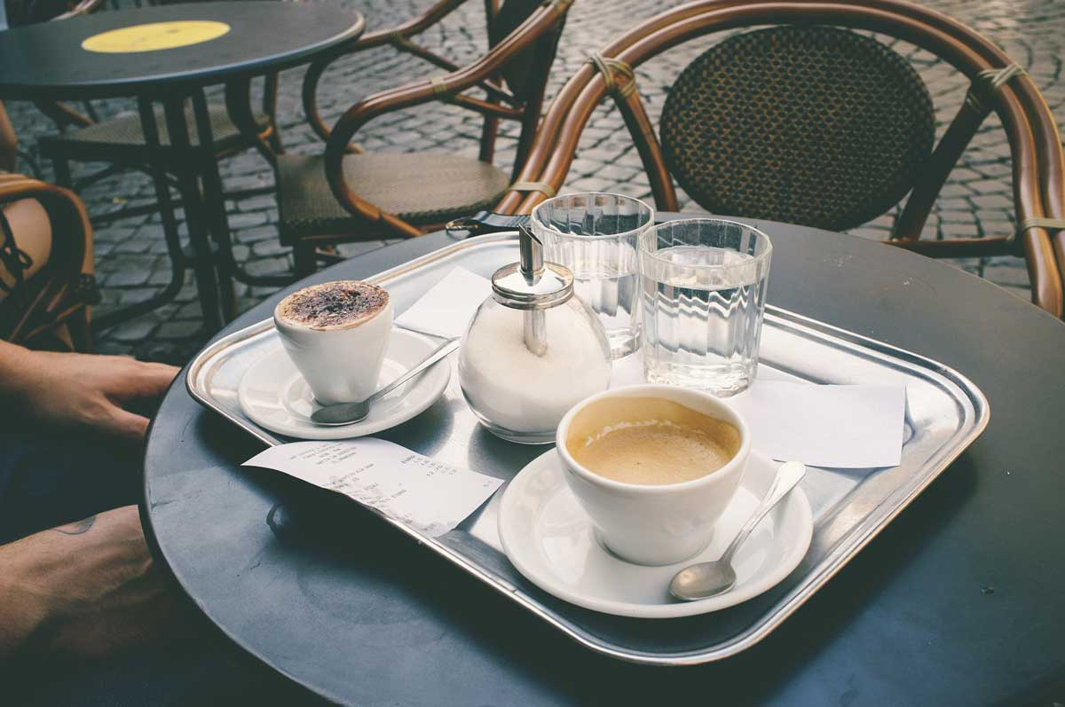 outside-table-with-capuccino-and-espresso
