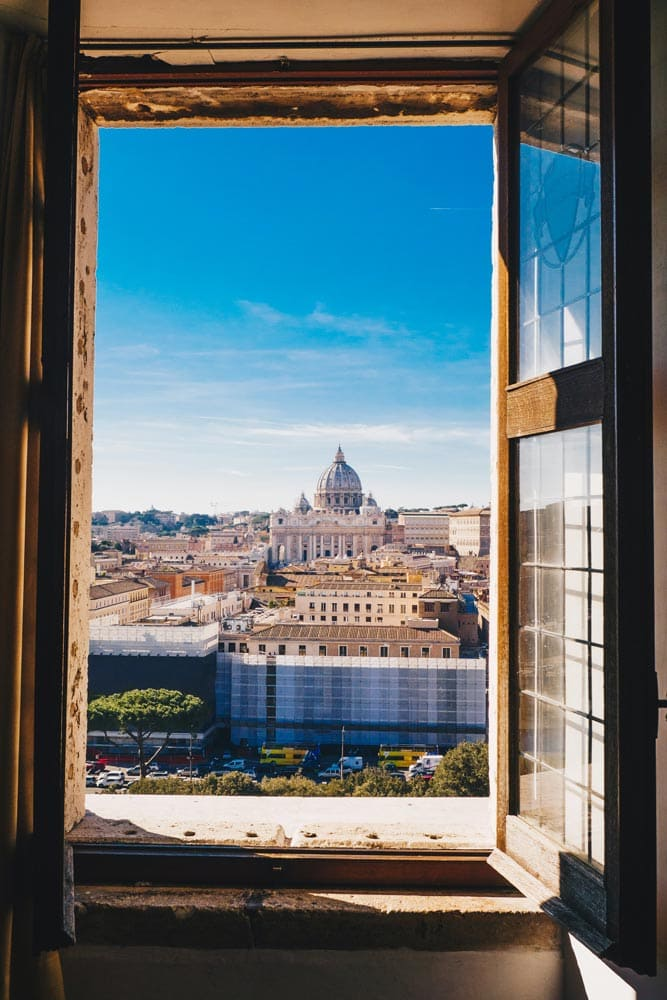 roman-panorama-behind-open-window