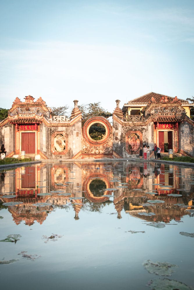 ancient-gate-with-pond-reflection-in-hoi-an