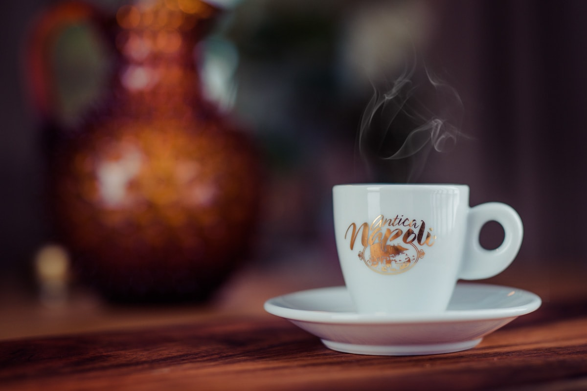 cup-of-esspresso-with-steam-over-it