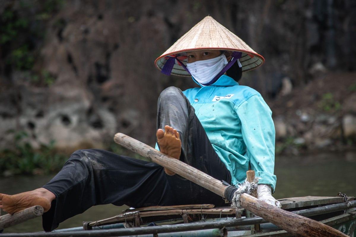 landmarks-in-vietnam-feet-boat-rower