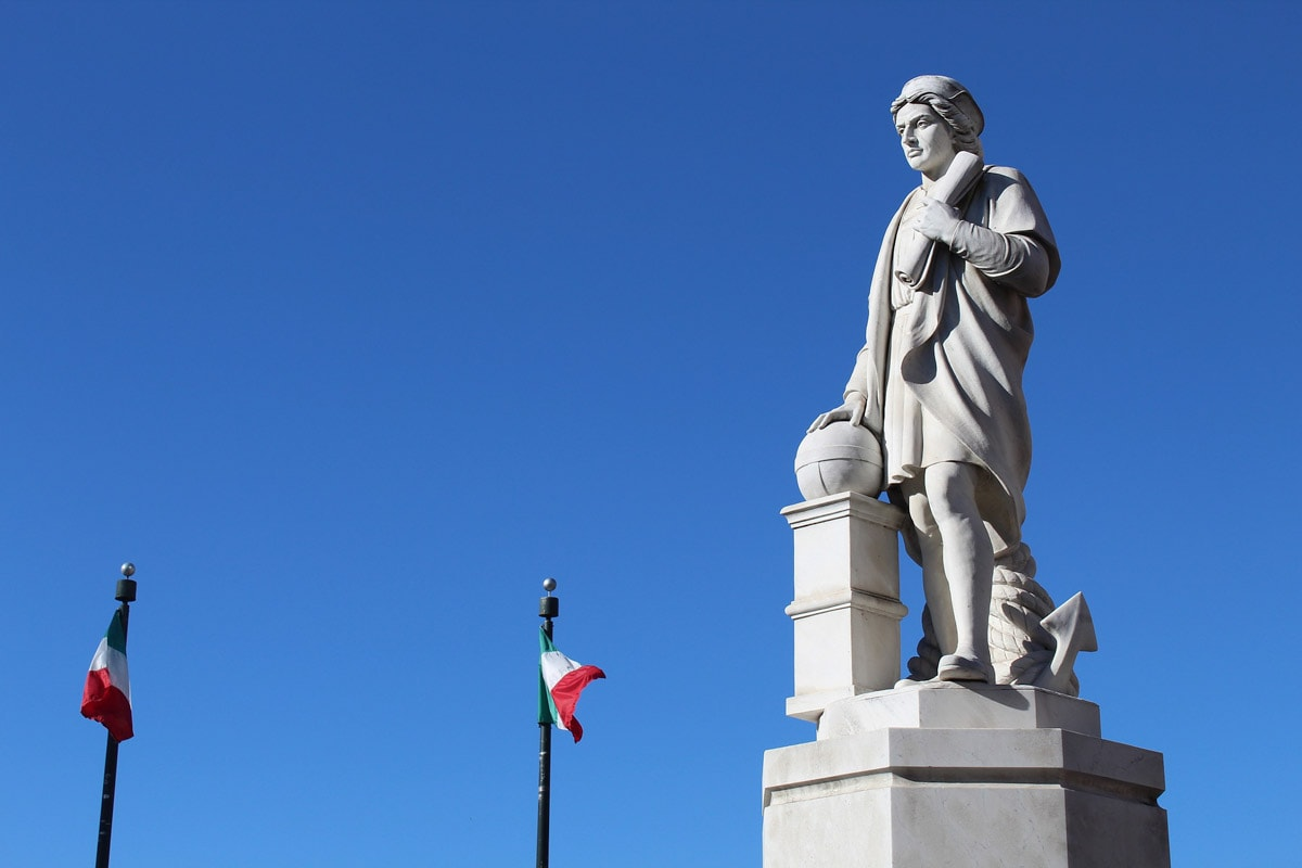 statue-of-columbus-with-two-italian-flags-in-the-background