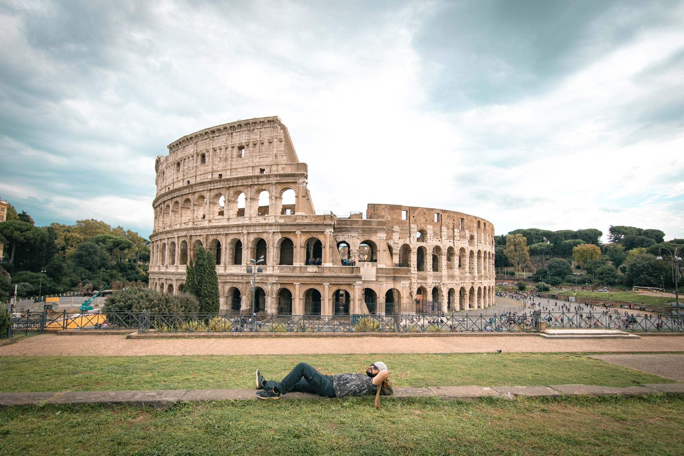 globalcastaway lying in front of the colosseum