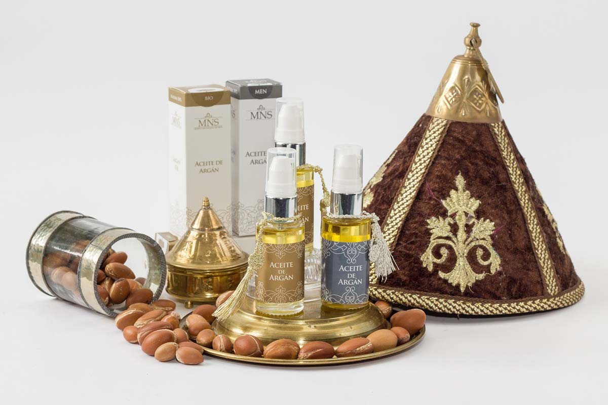 argan-oil-and-argan-seeds-spilled-on-a-white-background
