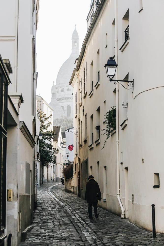 man-walking-in-a-misty-alley-of-montmartre