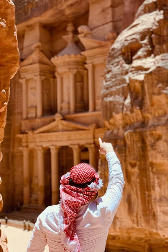 man-with-red-shemag-pointing-at-petra