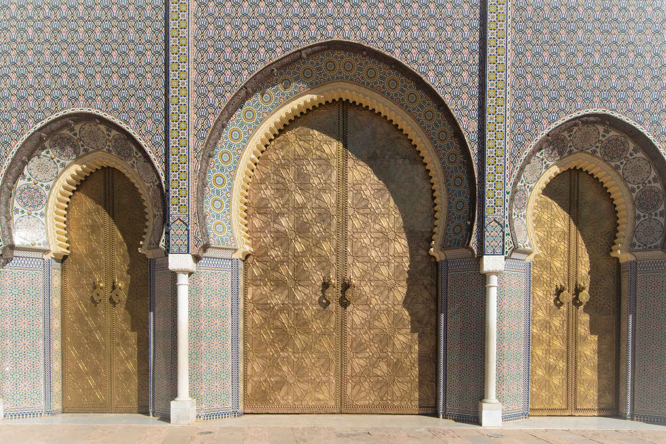 three golden royal palace doors in fez morocco