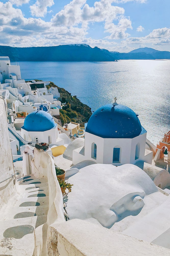 what is greece famous for -blue-domes-of-santorini-with-the-sea-in-the-background
