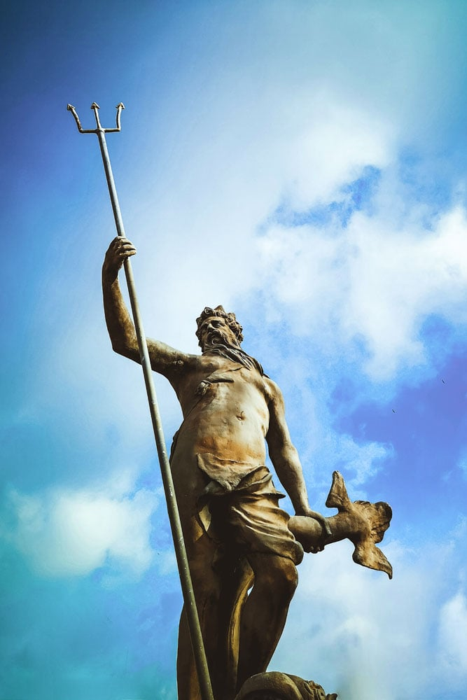facts-about-greece-poseidon-statue-with-a-cloudy-background