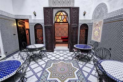typical moroccan interrior with ornamentet tables