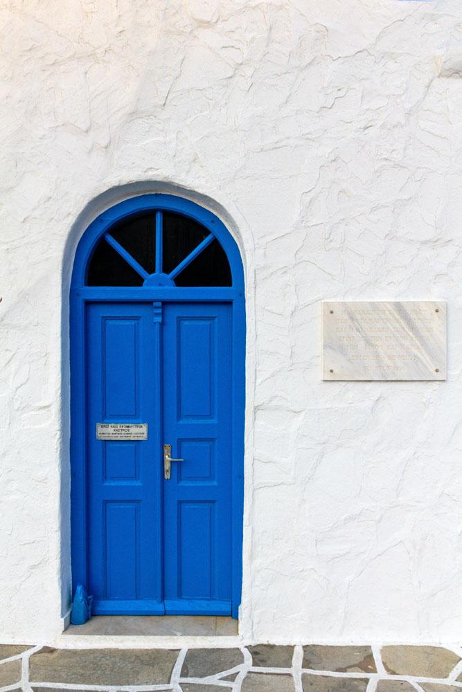greece-facts-blue-door-on-a-white-facade