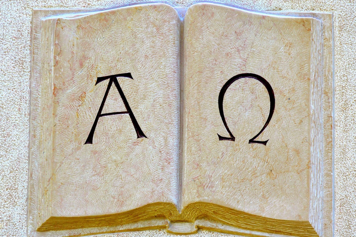 greek-facts-stone-book-with-alpha-nad-omega-symbols