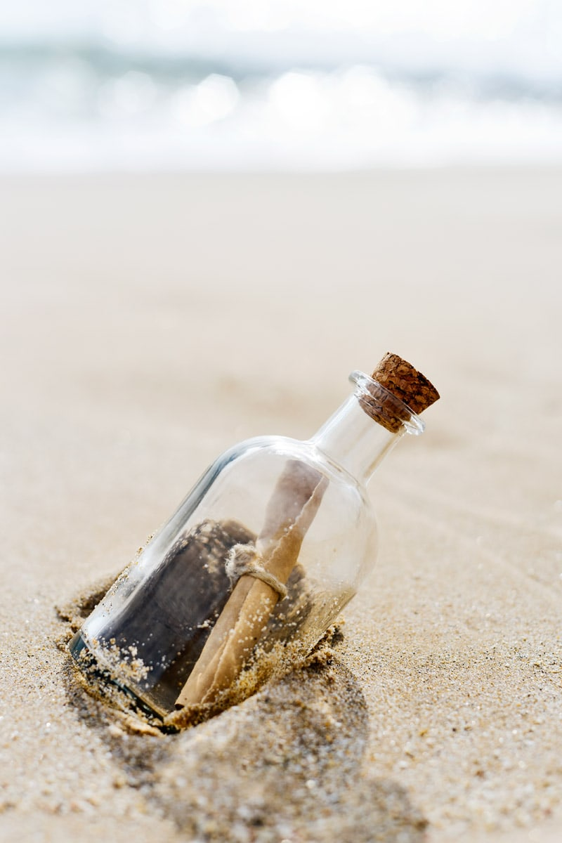message-in-a-bottle on a beach