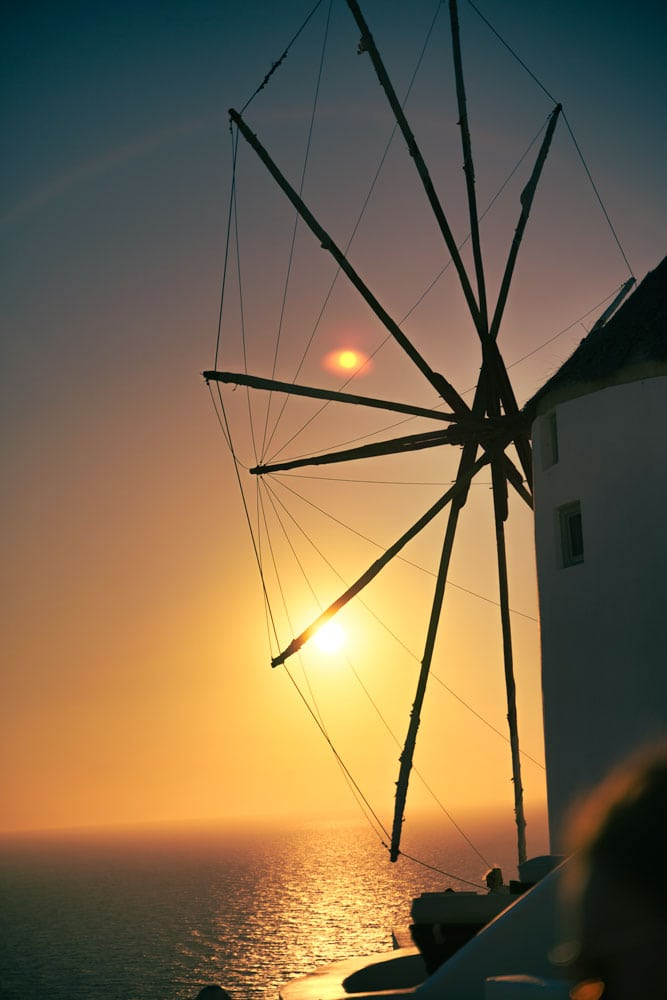 susnset-over-the-ocean-with-a-silhouete-of-a-greek-windmill