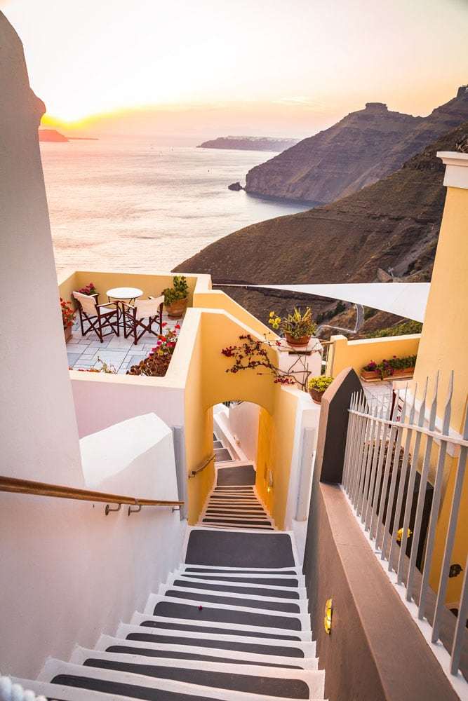 yellow-patio-in-santorini-with-the-ocean-in-the-background