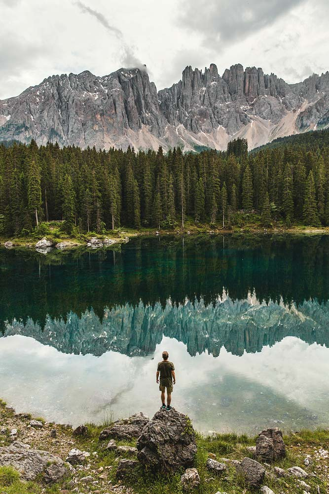 landmarks-in-italy-man-standing-in-front-of-a-lake
