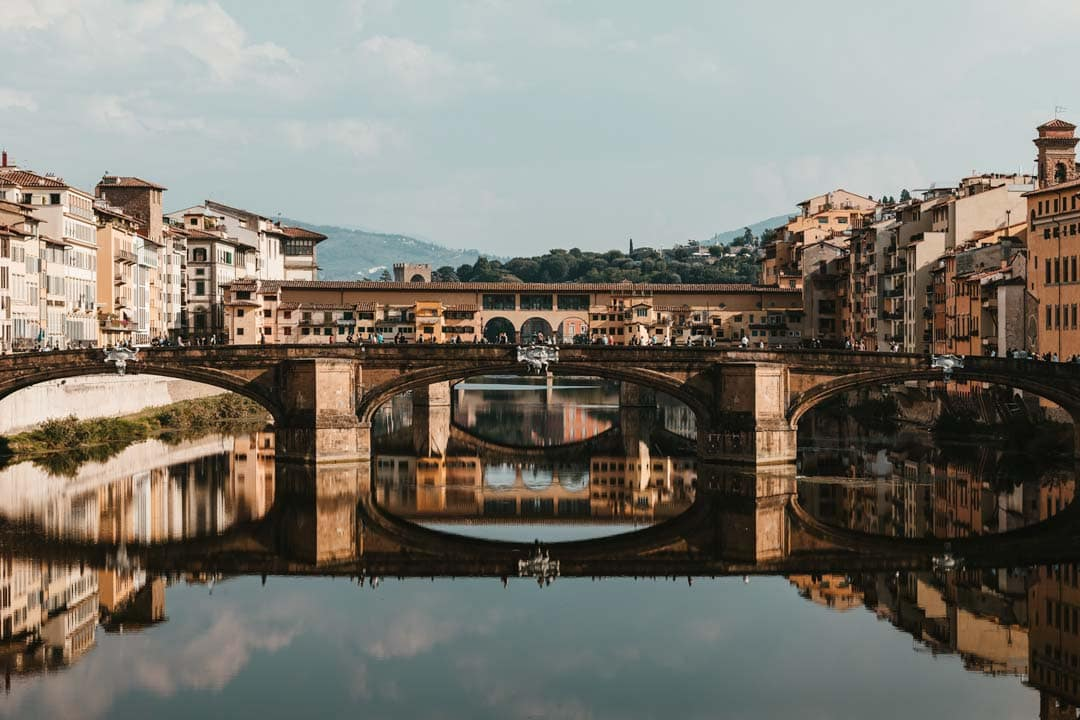 the-old-bridge-in-florence-with-hard-river-reflections
