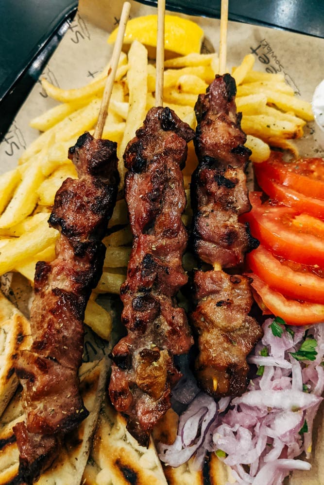what-greece-is-known-for-baked-meat-on-top-of-vegetables-and-fries