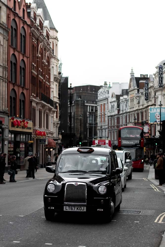 what-is-london-famous-for-black-cab-in-front-of-a-red-bus