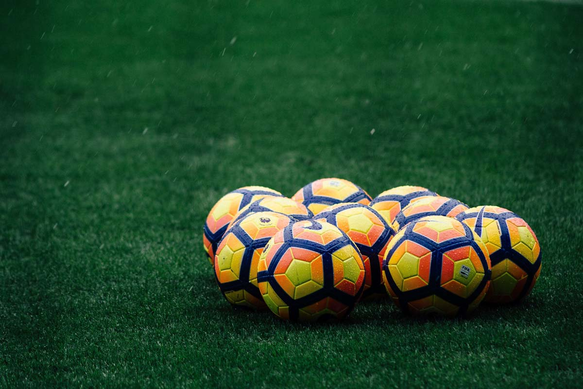 what-is-london-famous-for-ten-yellow-premier-league-balls-inside-a-stadium