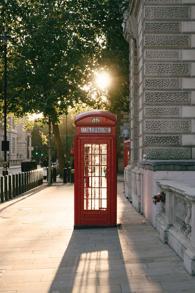 what-is-london-known-for-red-phone-booth-with-setting-sun-in-the-background