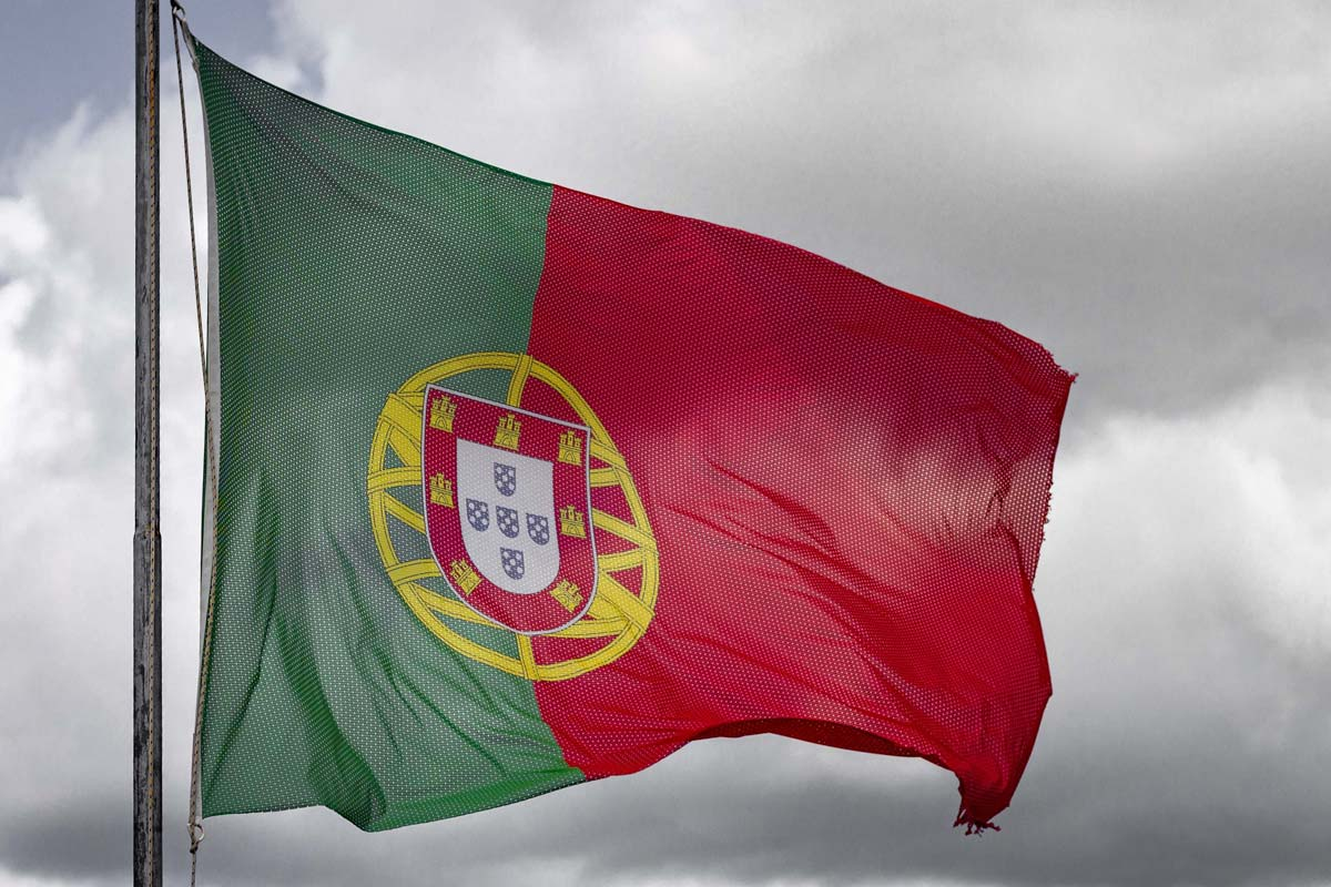 facts-about-portugal-the-flag-with-a-stormy-cloud-background