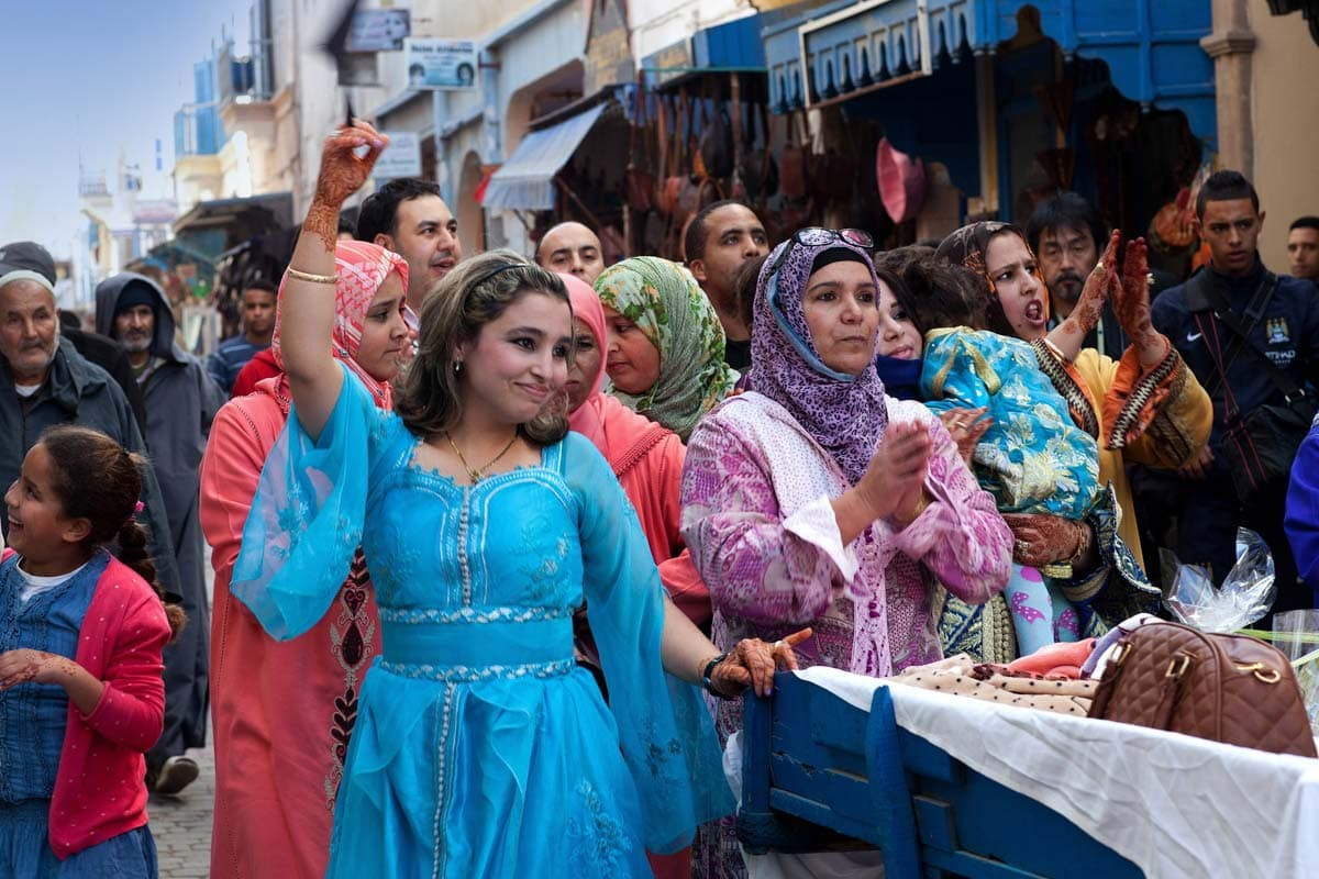 girl-with-a-blue-dress-dancing-on-Moroccan-wedding
