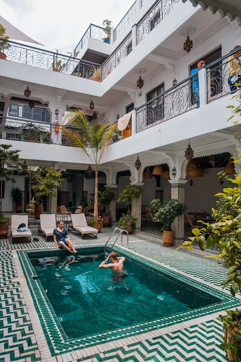 inside-yard-of-a-riad-with-a-pool-and-guest-bathing-in-it
